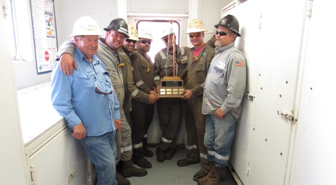 Part of the Trinidad Drilling Rig 134 team with their Rig of the Quarter award from Pioneer.