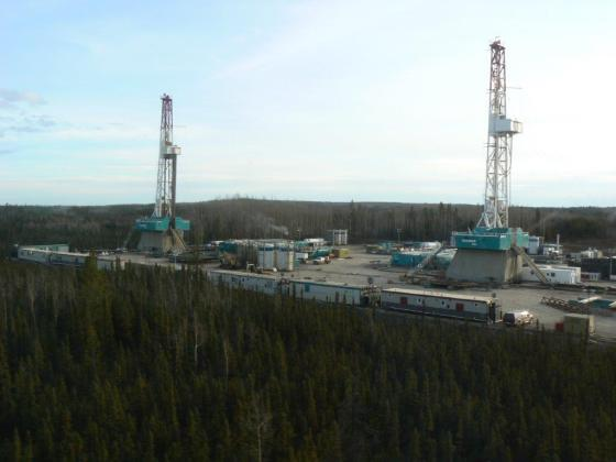 Trinidad Drilling Rigs 48 and 50 pad drilling in Fort Nelson, British Columbia